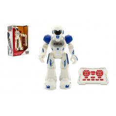 Robot chodiaci a tancujúci s ovládačom na batérie + USB kábel plast 25cm v krabici 25x32x11cm